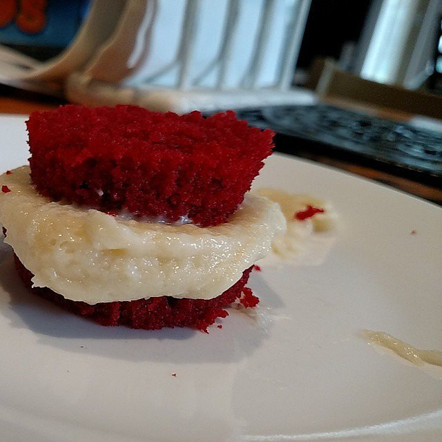 Eating cupcakes like sandwiches.