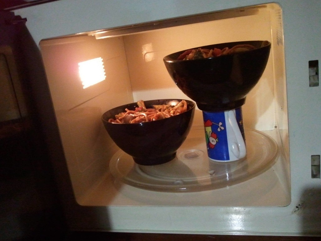 Heating two bowls in a microwave at once.